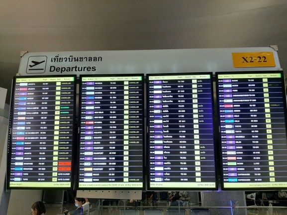 So many cancelled flights on the announcement board in Bangkok