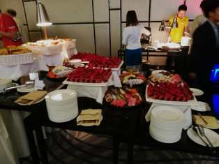 Buffet of a plethora of desserts consisting of croissants, fruits and mousse au chocolat