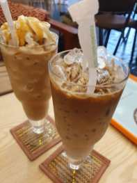 On especially hot days we loved Dit's selection of iced coffees, with or without whipped cream, ...