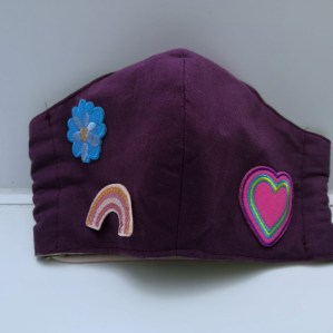 ... rainbow, flower and heart patches.