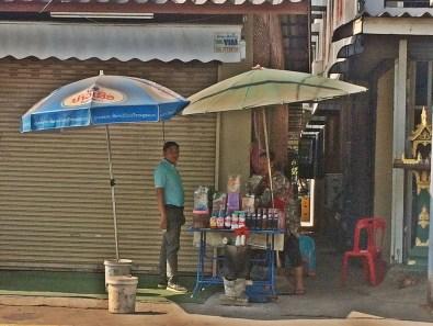Mr Khamphoun Sitthisay (VEDI) buys cafe yok lor at a street stall.