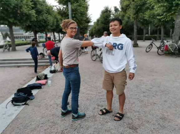 ... right elbow greeting at the Petanque match...