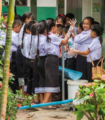Pupils in Laos wash their hands a group activity during their school day (UNICEF Lao P.D.R)