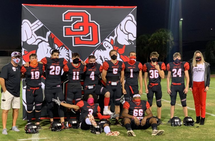 Varsity football: Cowboys tackle Senior Night