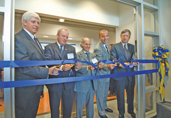 Ribbon cutting for the Center for Vaccine Research – From left: Donald S. Burke, U. S. Congressman Mike Doyle, Arthur S. Levine, Dan Onorato, Mark A. Nordenberg.