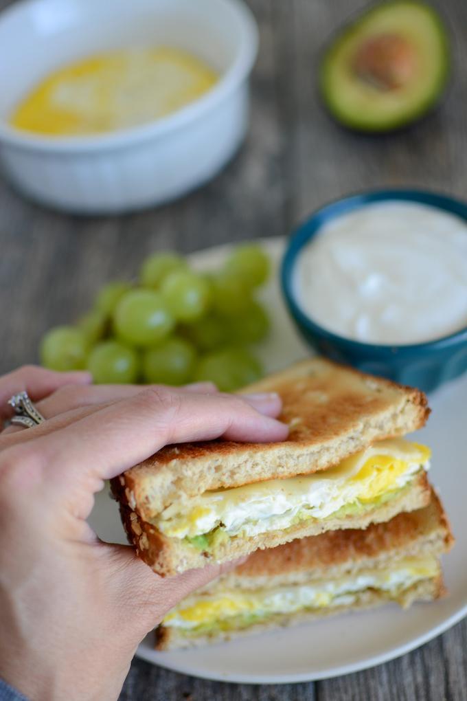 Handmade Microwave Egg Sandwich, Raisins, Yogurt, Egg and Avocado in the Background