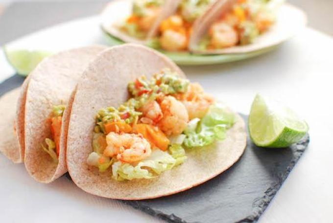 Slightly sweet and full of spice, these Spicy Shrimp Tacos are ready in 15 minutes, making them the perfect weeknight dinner!