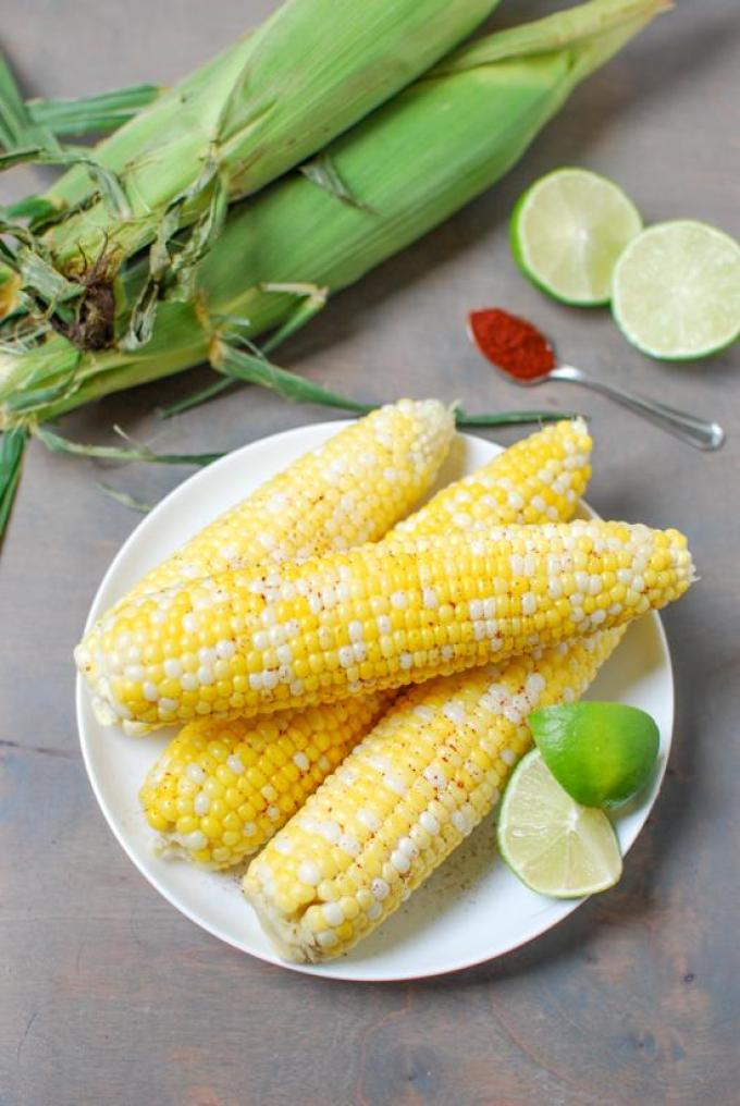 This Chili Lime Corn is the perfect balance of sweet and spicy. A fun way to jazz up your corn on the cob!