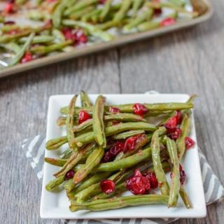 Bursting with flavor, these Roasted Ginger Garlic Green Beans with Cranberries make a great holiday side dish or a simple addition to your weeknight dinner table.