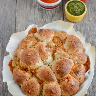 This recipe for Pesto Chicken Pizza Rolls is a fun way to change things up from traditional pizza. Serve them warm or cold, for lunch or dinner. They're easy to make and kid-friendly as well!
