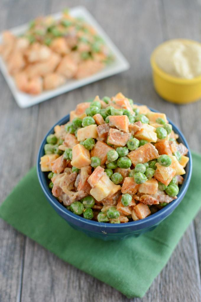 This Pea Salad with Sweet Potatoes is a healthy, kid-friendly recipe the whole family will love for dinner. Covered in hummus and mixed with bacon and cheese, what's not to love about this side dish?