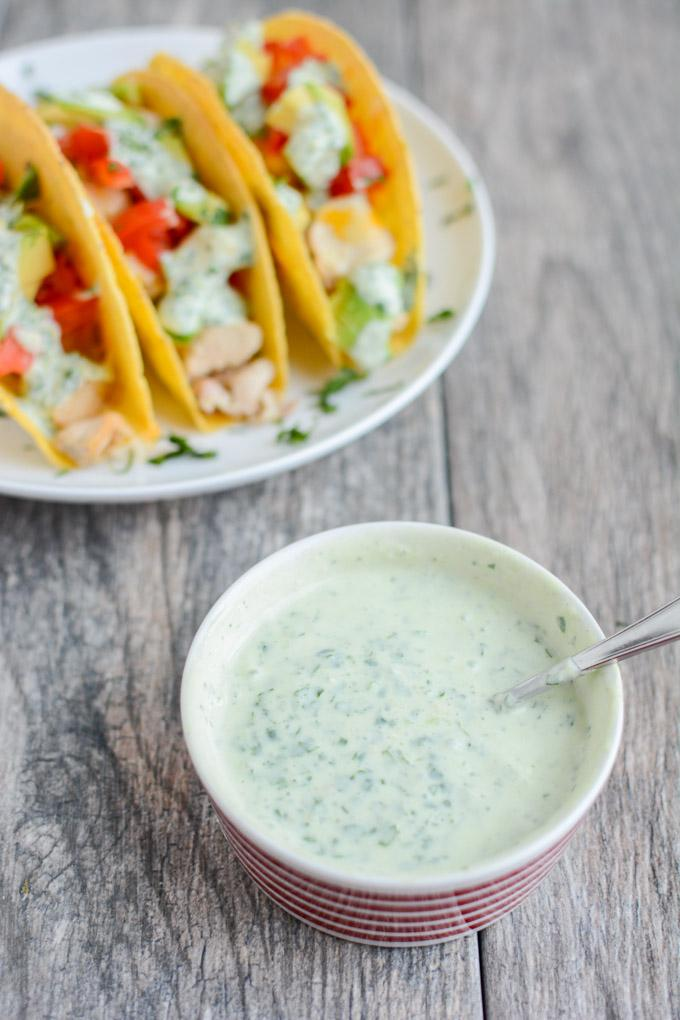 These gluten-free Baked Chicken Tacos with Creamy Cilantro Sauce will quickly become a favorite family dinner recipe!