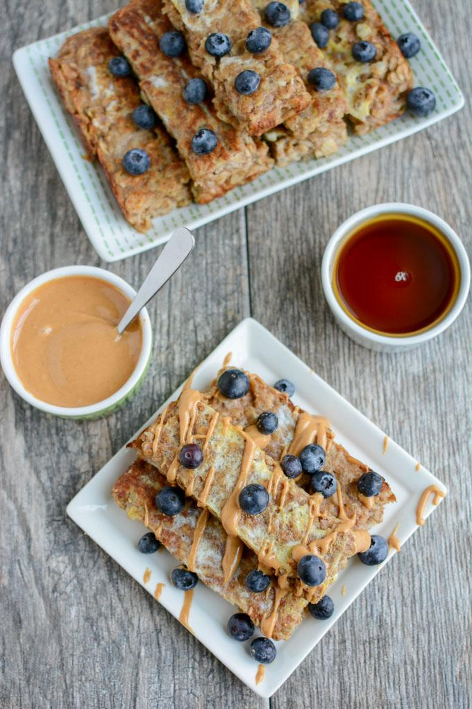 These Banana Baked Oatmeal French Toast Sticks are a healthy, kid-friendly breakfast recipe. They can even be made ahead of time, stored in the freezer and reheated in the microwave!