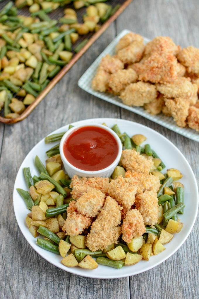 These Crispy Chicken Potato Bowls with Sweet Sweet and Spicy Ketchup are cooked on a sheet pan for an easy, healthy dinner recipe the whole family will love.
