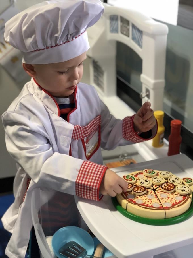 toddler in chef outfit