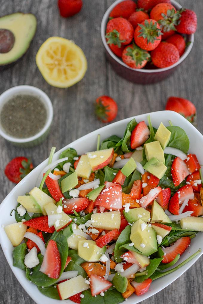 Loaded strawberry spinach salad with lemon poppyseed dressing