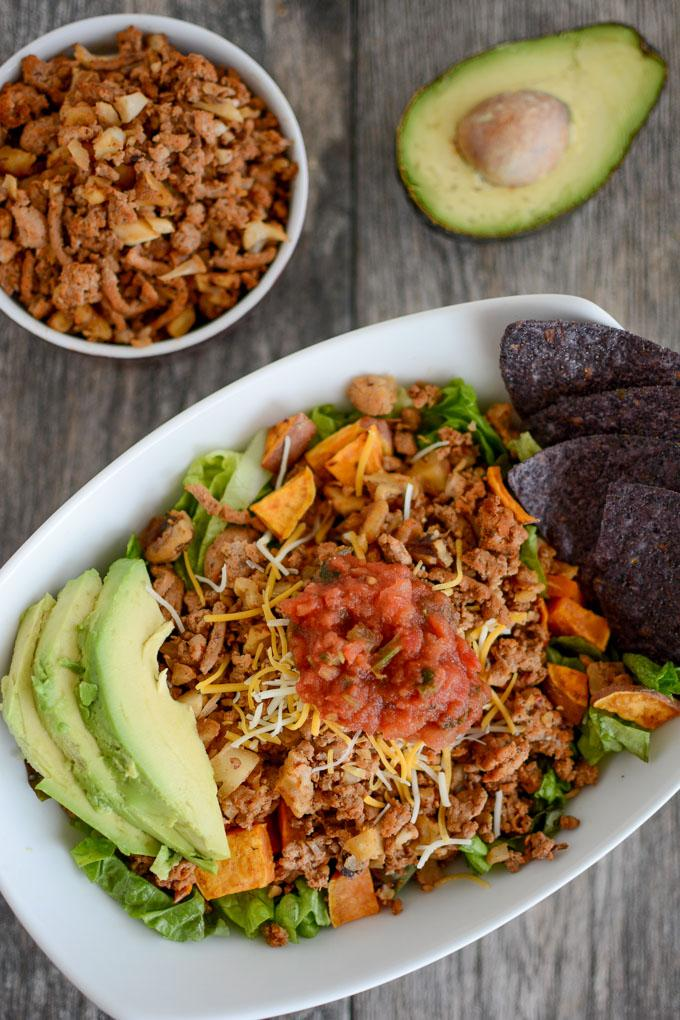 Turkey Walnut Taco Meat in a taco salad with roasted sweet potatoes and avocado