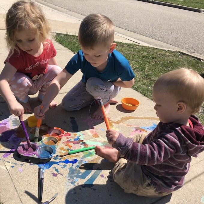 kids with sidewalk chalk paint