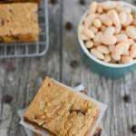 Sweet Potato White Bean Bars - stacked, on cooling rack and a bowl of beans