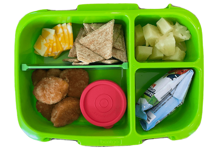 kids lunch box idea - chicken nuggets, yogurt tube, cheese and crackers and fruit
