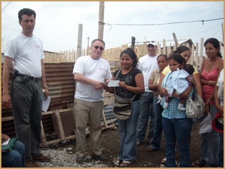 Ron giving a check to a sponsor, 2006.