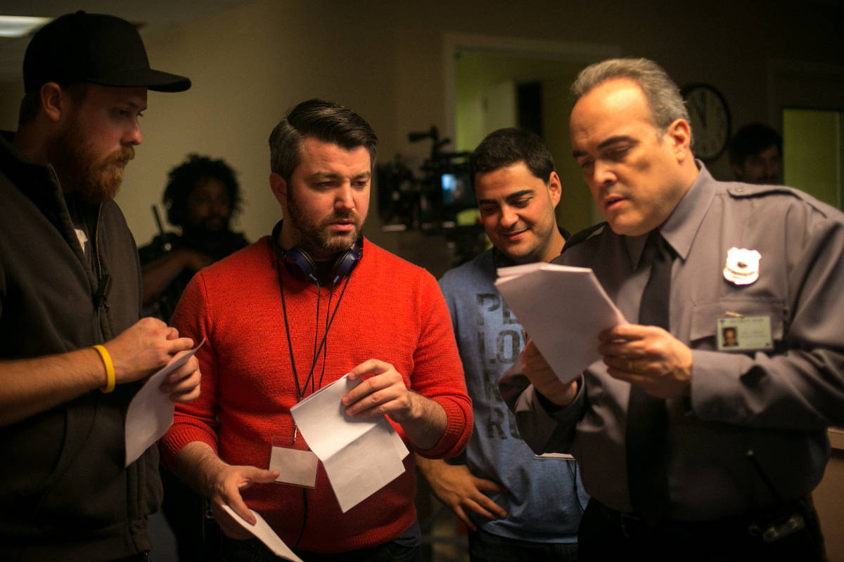 1st AD Blake Brewer, Director Jeremy Profe, and Producer Gabriel Francisco review an upcoming scene with David Zayas.