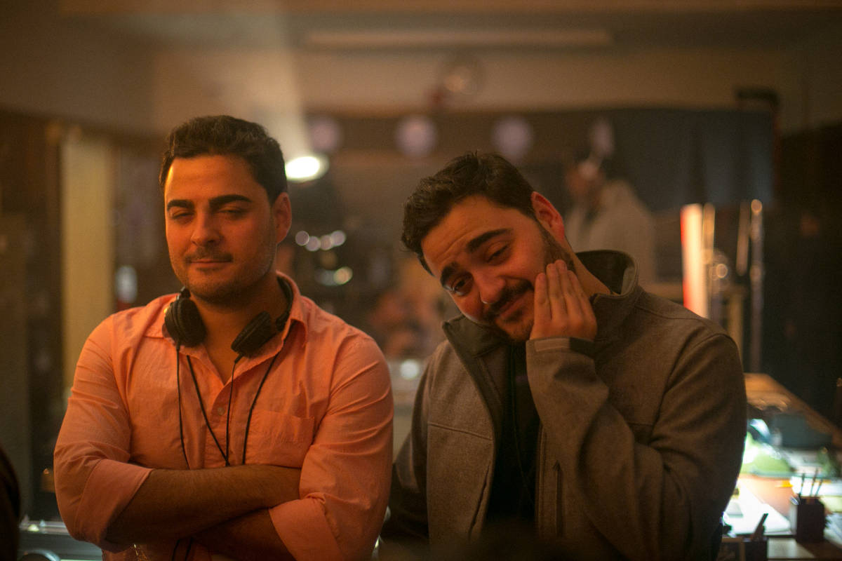 This light hearted photo captures the Francisco brothers enjoying a rare moment to relax between takes.