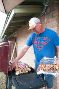 Bob Kehoe grilling kabobs on faulty grill