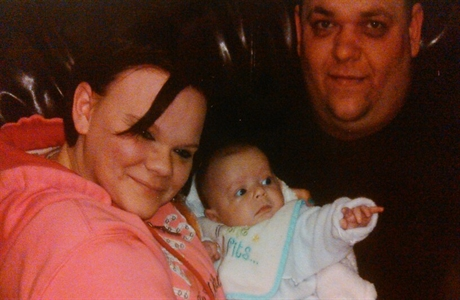 Makenzie-with-mom-and-dad-460