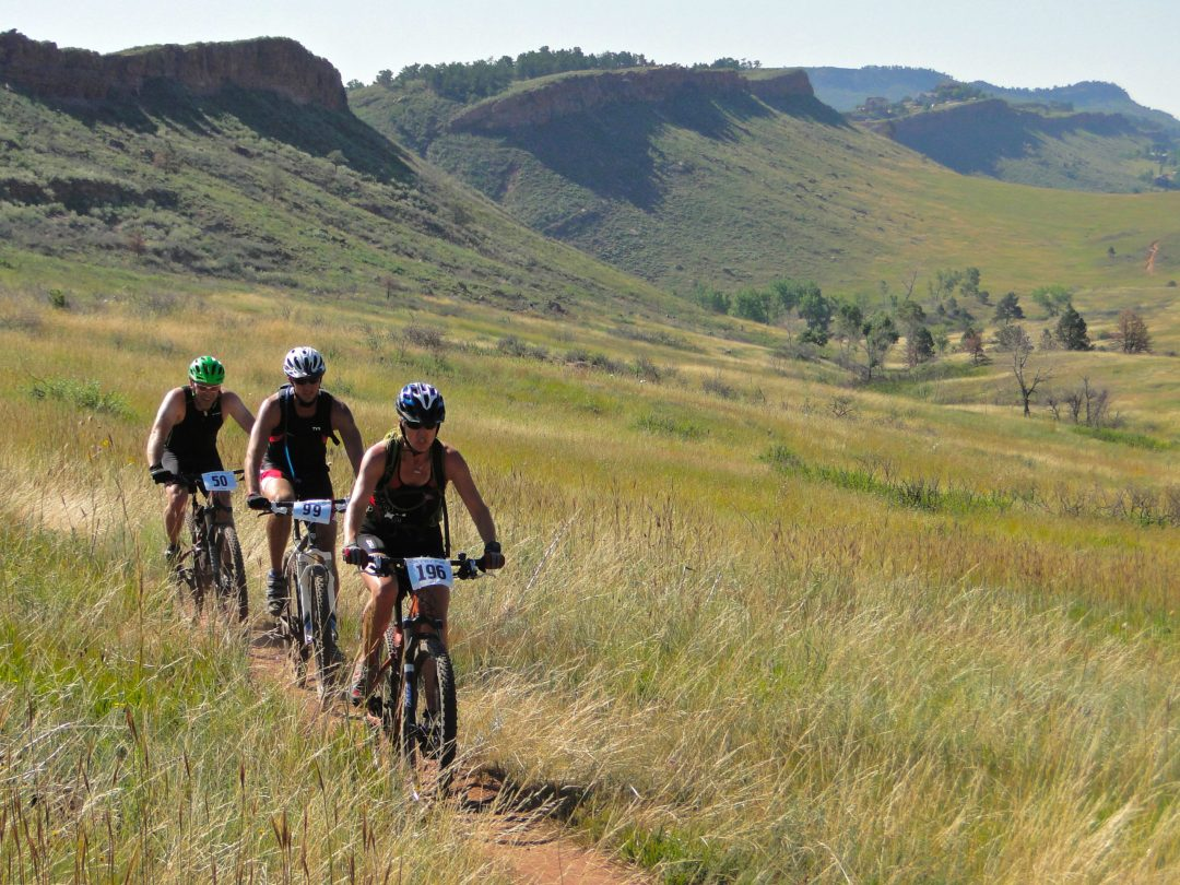 photo of three mountain bikers on hilly plain in Bellvue Colorado near Fort Collins