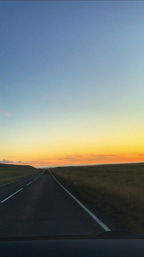 Travel Iceland on a Budget by Hiring a Car and seeing an Icelandic sunset