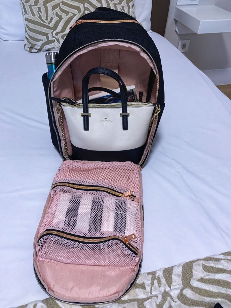 Minimalist Travel Backpack with 20L Capacity containing my Travel Hack Packing Cubes, Book & Kate Spade Handbag