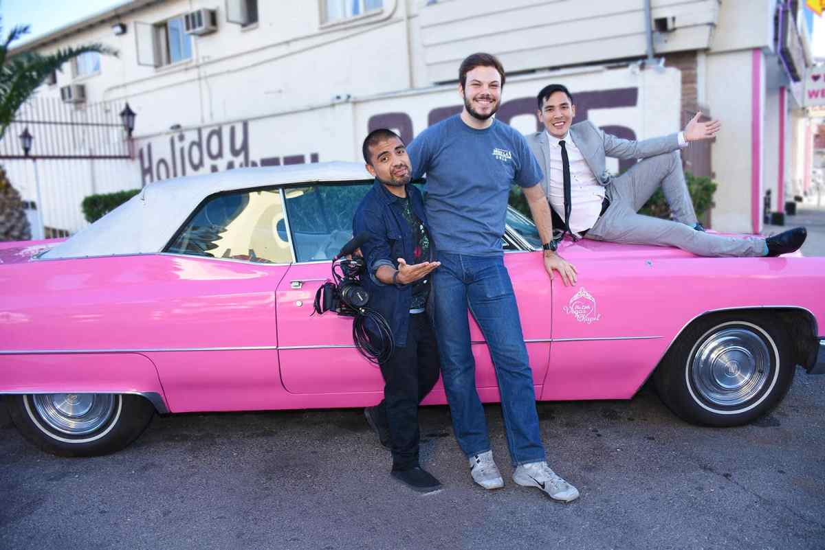 buzzfeed gets married team poses with iconic pink cadillac