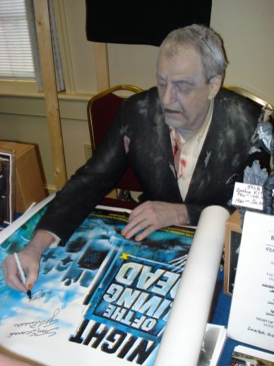 Bill Hinzman autographing a Night of the Living Dead British Quad movie poster