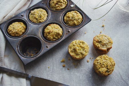 Firecracker Zucchini Cornbread Muffins on grey sheet in muffin tin