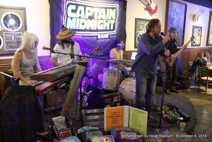 """Chris Sartin, owner of Soulshine Pizza Factory, sings """"Will The Circle Be Unbroken"""" with The Captain Midnight Band in honor of Stan Sandroni, Ole Miss' radio personality who recently passed away."""