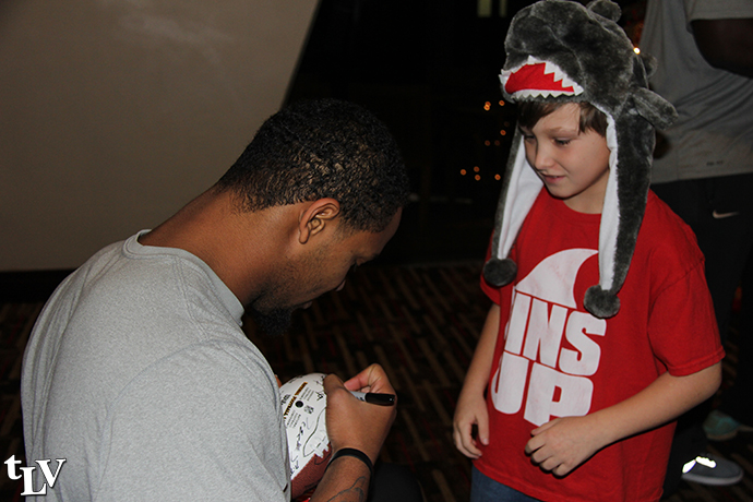 issac signs autograph