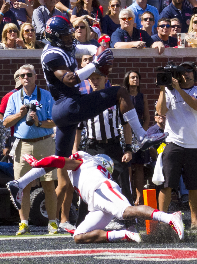 Ole Miss Reciever Cody Core scores the opening touchdown for the Rebels against the Fresno State Bulldogs on Saturday, September 12, 2015. Photograph by Shelby Rayburn - The Local Voice.