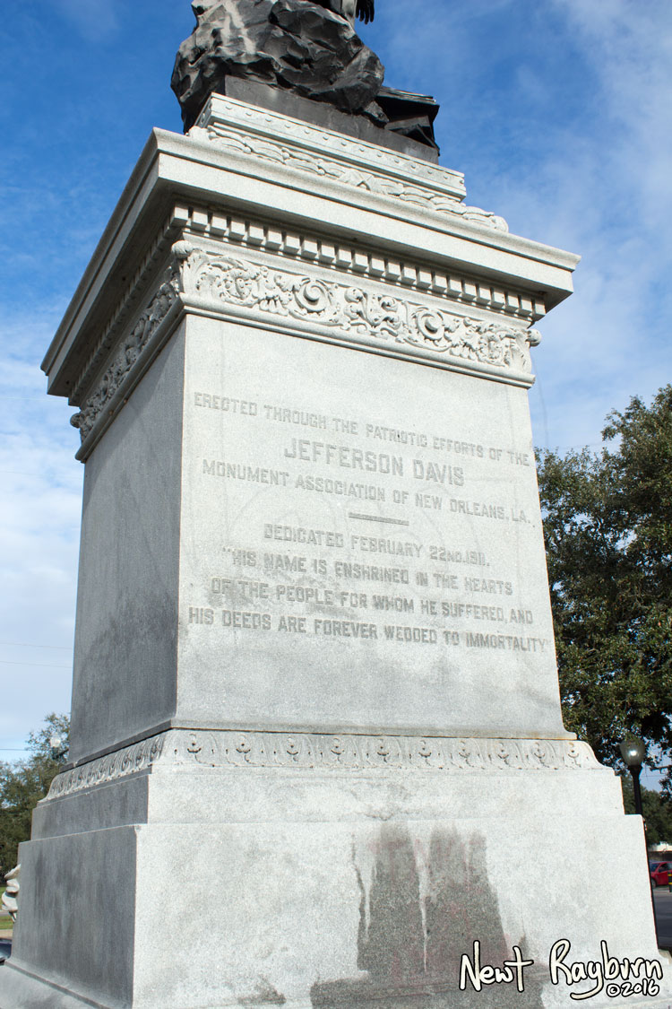 "The Jeff Davis Monument on January 2, 2016, at the intersection of Canal Boulevard and Jefferson Davis Parkway in New Orleans, Louisisana. Photograph © 2016 Newt Rayburn – newtrayburn@gmail.com. Inscription reads, ""ERECTED THROUGH THE PATRIOTIC EFFORTS OF THE JEFFERSON DAVIS MONUMENT ASSOCIATION OF NEW ORLEANS, LA. DEDICATED FEBRUARY 22ND 1911. 'HIS NAME IS ENSHRINED IN THE HEARTS OF THE PEOPLE FOR WHOM HE SUFFERED, AND HIS DEEDS ARE FOREVER WEDDED TO IMMORTALITY.'"""