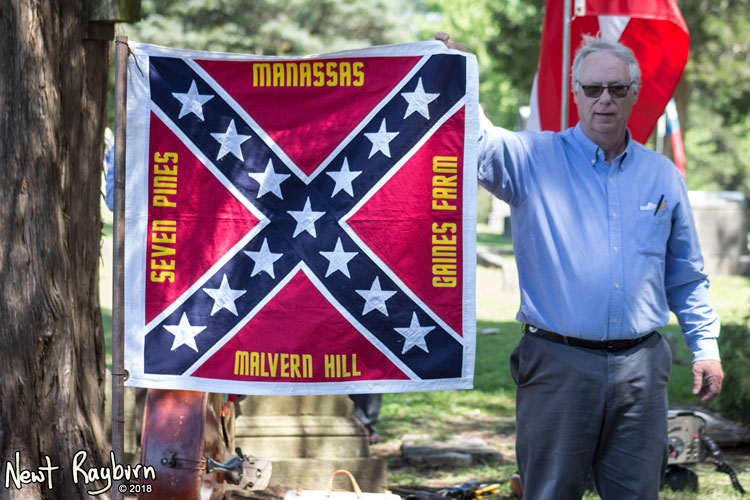 Larry Mardis shows off a replica flag of the 11th Mississippi Infantry from the Civil War. Photograph by Newt Rayburn - © May 6, 2018.