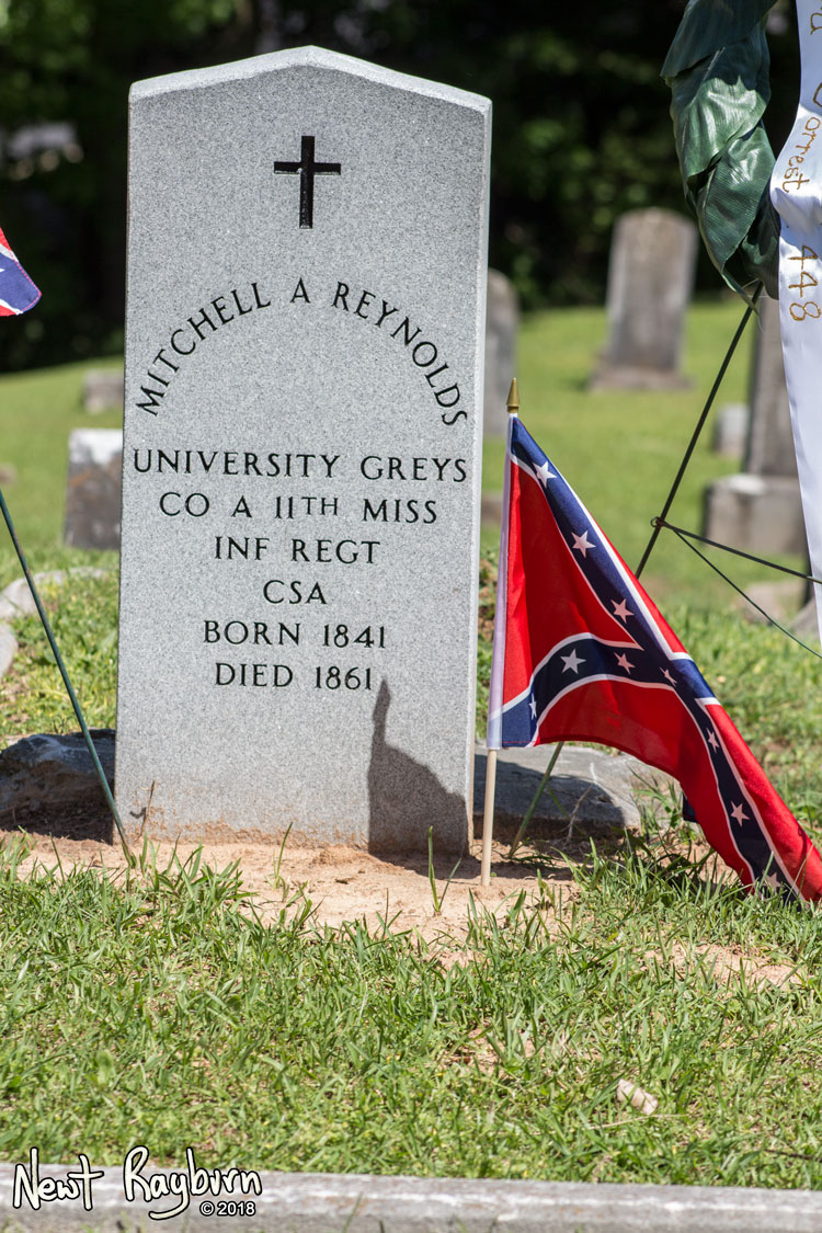 "A new tombstone at the grave of Mitchell A. Reynolds, a Confederate soldier and member of the Company A of the 11th Mississippi Infantry, the ""University Greys"". Photograph by Newt Rayburn - © May 6, 2018."