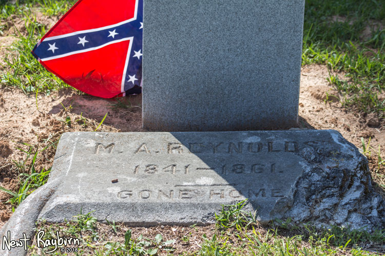 "The original tombstone at the grave of Mitchell A. Reynolds, a Confederate soldier and member of the Company A of the 11th Mississippi Infantry, the ""University Greys"". Photograph by Newt Rayburn - © May 6, 2018."