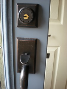 Kwikset deadbolt retrofitted with Mul-t-lock high security cylinder