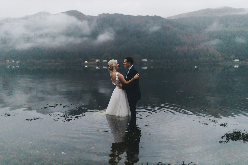 An elopement couple in the water at Loch Goil