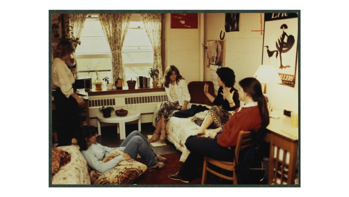 I was in college in the mid to late 80's, and looking at this photo is eerily familiar.  I think I had the wedge/ankle strap shoes (or some very similar), and check out the vintage Nike's!   Boston College Library Digital Collection