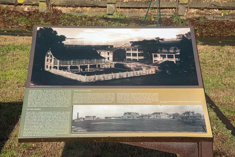 A historical photo of Lumpkin's Jail appearing on a historical marker in Richmond, Virginia.