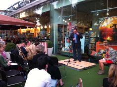 Steven O'Brien, judge of the 'Indian Summer' poetry competition, announces the winning entries