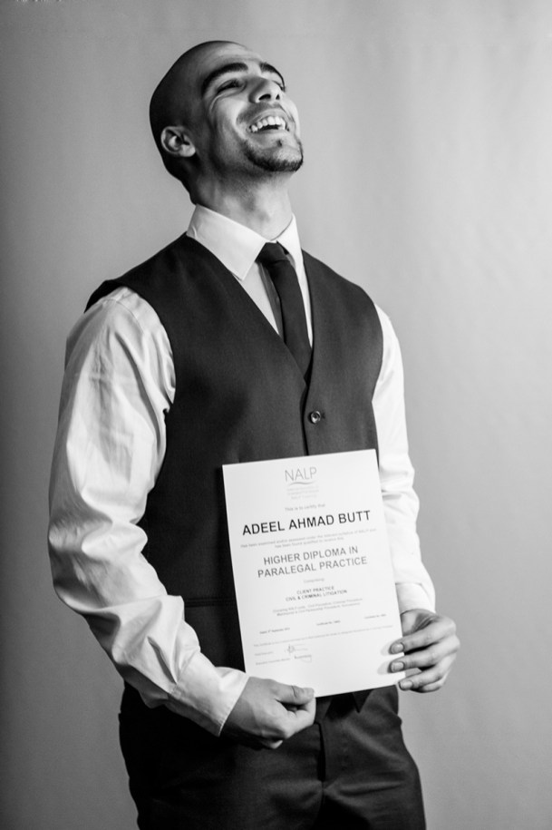 Studio-photography-laughing-law-graduate