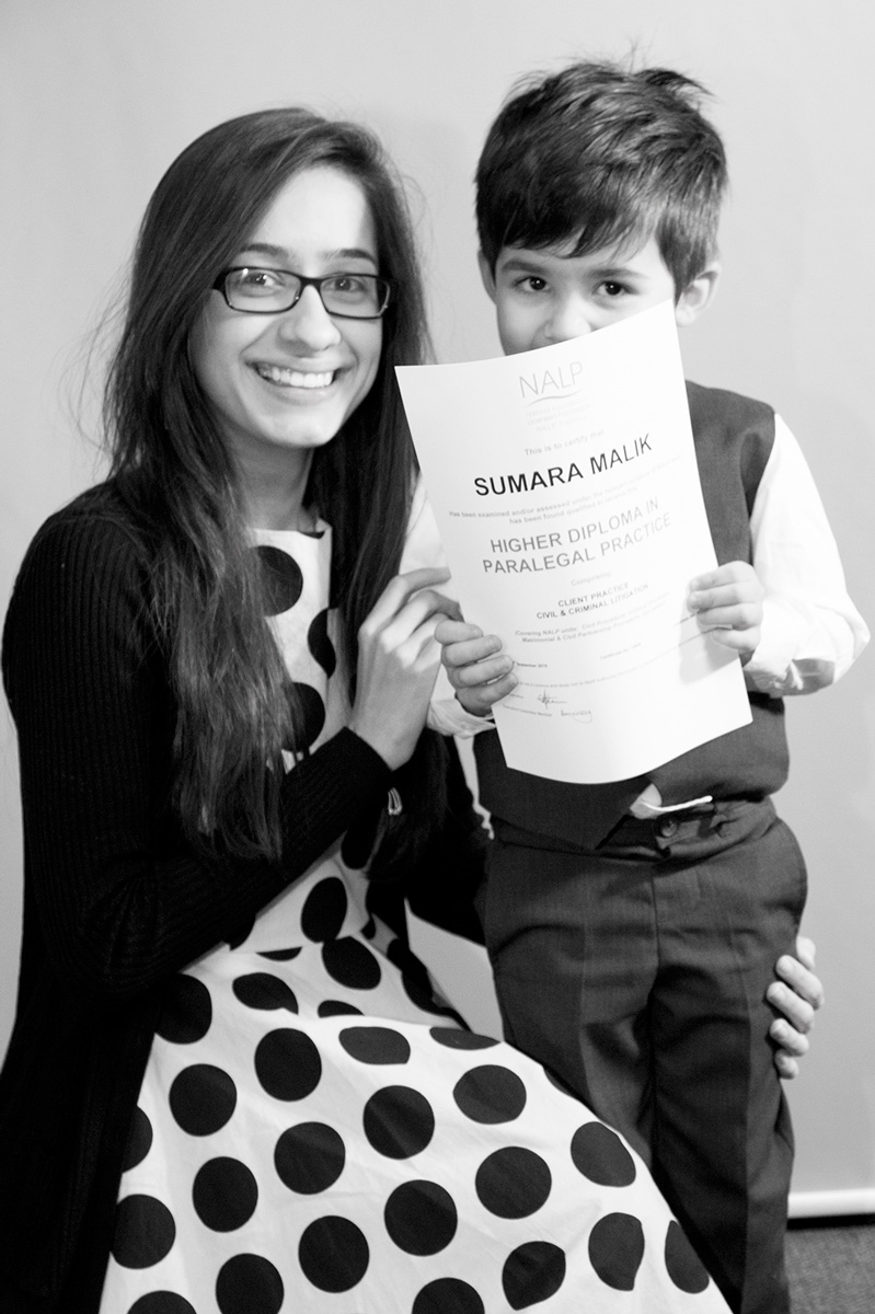 photo-of-mother-and-young-son-with-certificate