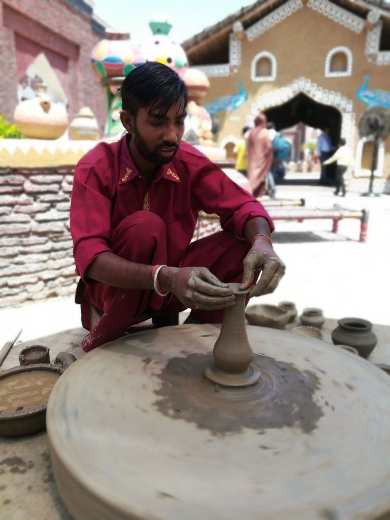 Pottery at Haveli amritsar. Potter's wheel spinning.